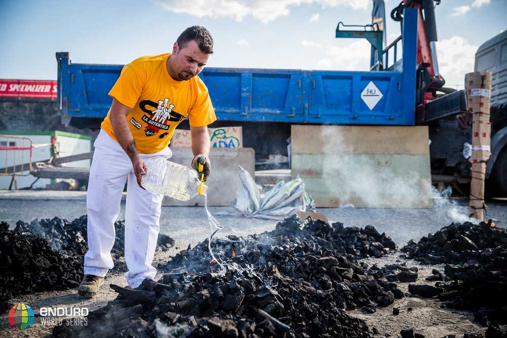 Preparing the charcoal for the festival. EWS round 7, Ainsa, Spain. Photo by Matt Wragg.