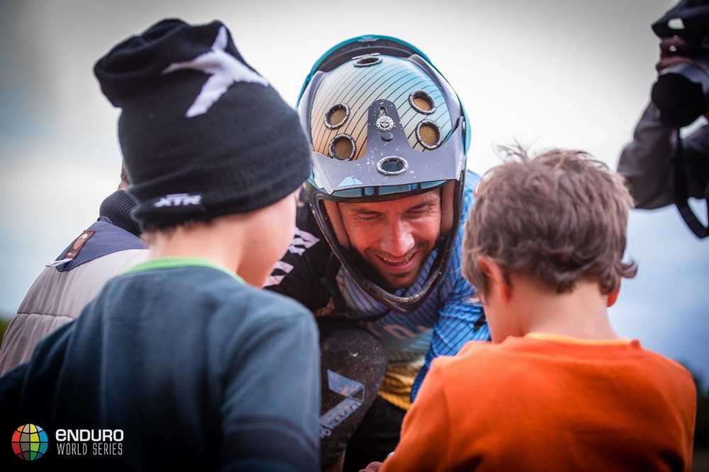 Fabien Barel signs autographs for local kids. EWS round 7, Ainsa, Spain. Photo by Matt Wragg.