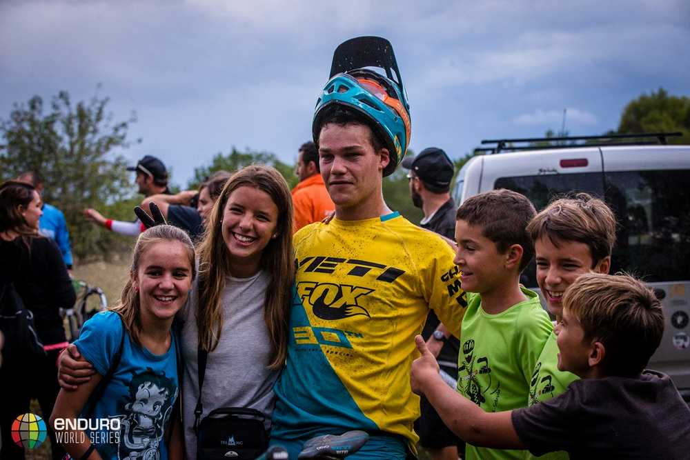 Richie Rude poses for a photo with some fans. EWS round 7, Ainsa, Spain. Photo by Matt Wragg.