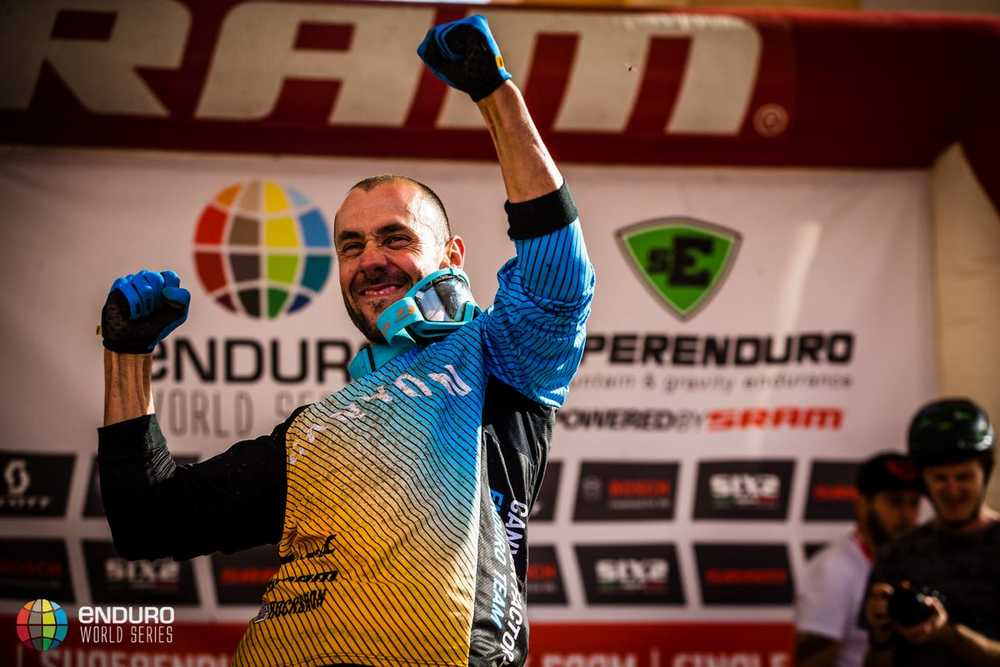 Fabien Barel celebrates his result as he comes on stage to announce his retirement. EWS round 8, Finale Ligure, Italy. Photo by Matt Wragg.