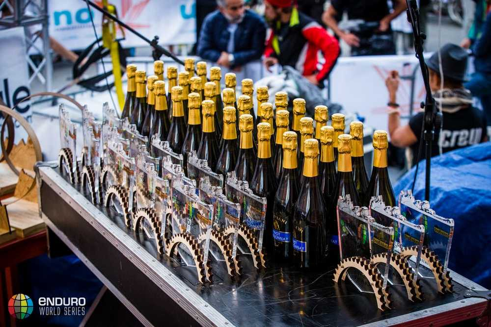 Medals and champagne. EWS round 8, Finale Ligure, Italy. Photo by Matt Wragg.