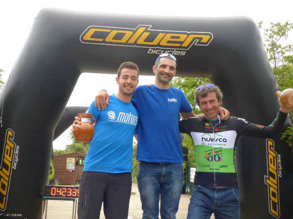 Podium masculino con Roger Argelaguer, Xavier Jov&#233_ y &#211_sc_ar Puyuelo