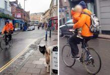 ciclista circula con un niño en brazos por la ciudad