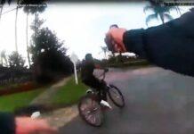 policia dispara con una pistola taser a un ciclista